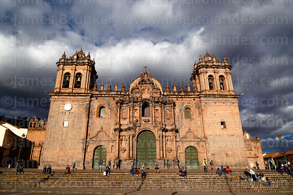 Entrance facade of cathedral on a stormy afternoon, Cusco, Peru