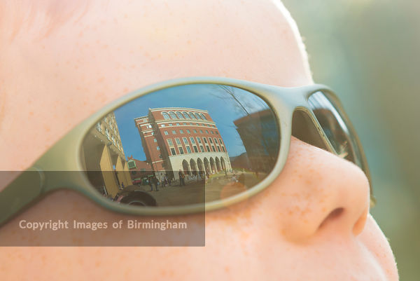 Brindleyplace refelcted in the sunglasses of a child. Brindleyplace, Birmingham