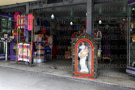 Virgin Mary statue and candles in shop selling religious objects, Lima, Peru