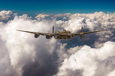 Avro Lancaster above clouds