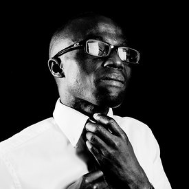 African man portrait with tie and glasses