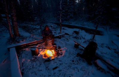 Hiker sitting by the fire