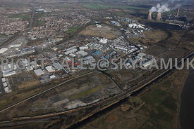 Widnes high level aerial photograph of old Industrial disused land between the St Helens Canal and Moss Bank road looking towards Gorsey Lane and Fiddlers Ferry road in the distance