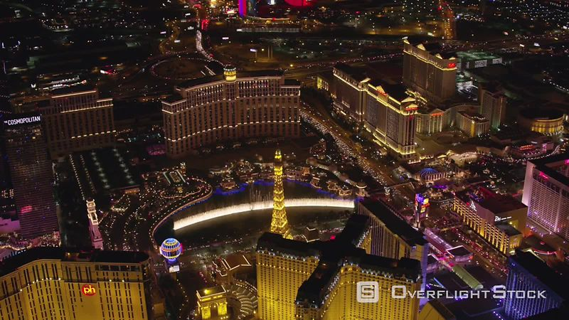 Las Vegas, Nevada Orbit Bellagio fountain and Las Vegas Strip at night.  Shot with Cineflex and RED EpicW Helium.