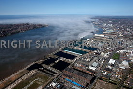 Liverpool wide angle aerial photograph of Low lying cloud and fog rolling in over the River Mersey and Liverpool Docks