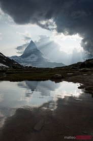 Matterhorn reflected in Riffelsee lake at sunset