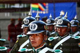 Members of the military police wearing old German style pickelhaube spiked helmets during military parades for Day of the Sea / Dia del Mar, La Paz, Bolivia
