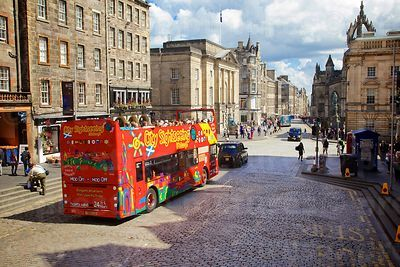 Open top Sight Seeing City Bus in Lawnmarket in the Centre of Edinburgh