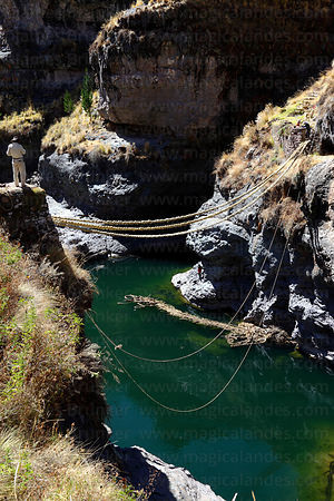 New foundation ropes in position, old bridge floating in river, Q'eswachaka , Canas province , Peru