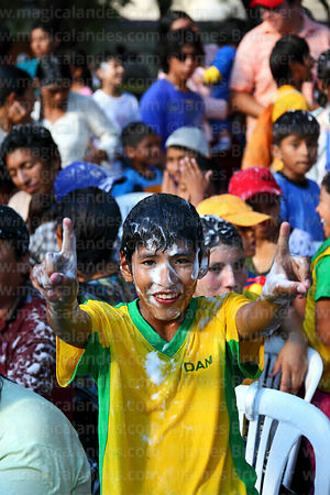Portrait of young spectator covered in shaving foam at carnival, Tarija, Bolivia