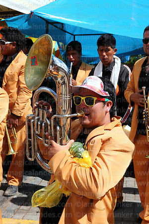 Brass band playing at street party after formal parades, Virgen de la Candelaria festival, Puno, Peru