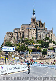 Cycling in Front of Le Mont Saint Michel
