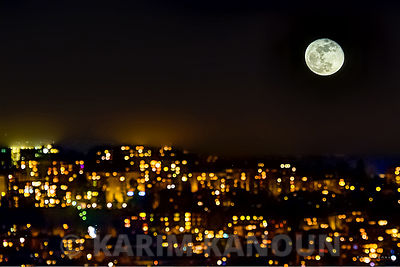 Full moon with City light