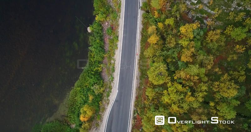 Autumn Color Road, Aerial Tilt View of a Car and a Trailer, on 970 the Tenontie Road Full of Different Fall Colors, Near Tenojoki River, on a Sunny Evening Dawn, in Lapland, Finland