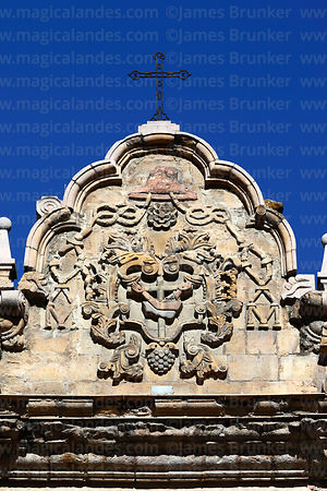 Cross with Franciscan crossed arms symbol above main entrance of San Francisco church, La Paz, Bolivia