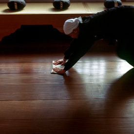 A Zen monk of the Soto School cleans the meditation hall in the traditional manner at the Seiryu-ji Temple in Hikone City