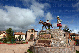 Monument showing local inhabitants and attractions in Plaza de Armas, Maras, Cusco Region, Peru