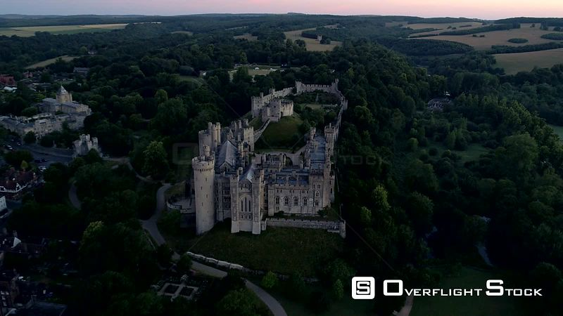 Drone moves slowly back from Arundel Castle at dawn to reveal Sussex countryside