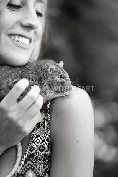 B+W woman snuggling rat