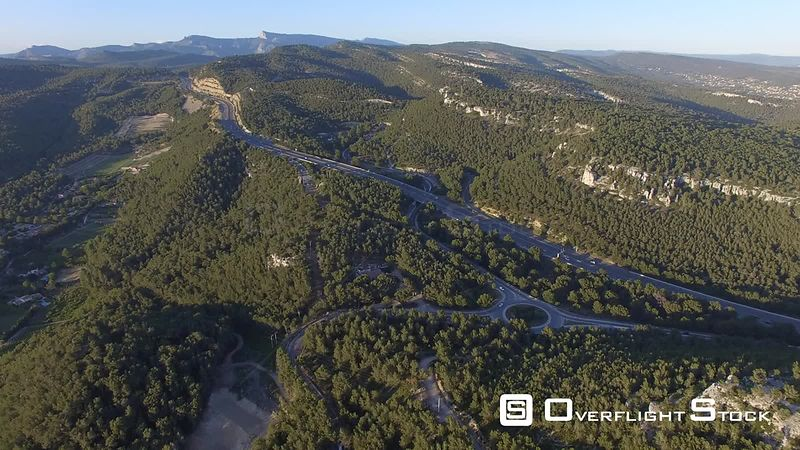 Aerial view of a highway nearby Cassis at sunset, filmed by drone, France
