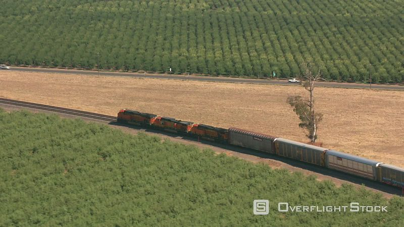 California Aerial shot of a train traveling though Northern California farmlands.  Shot with Cineflex and RED EpicW Helium.