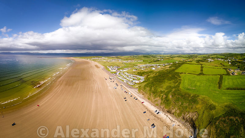 Golden Sands, blue sky and lush green fields at Rossnowlagh in County Sligo, Ireland