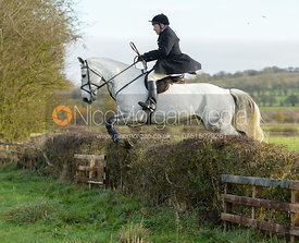 Richard Hunnisett jumping a hedge on Deane Bank