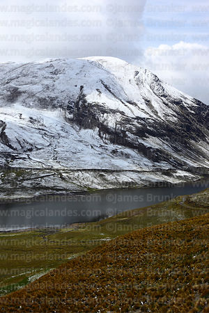 Hillside above Incachaca Reservoir near La Paz after winter snowfall, Cordillera Real, Bolivia