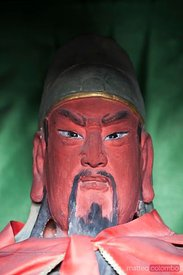 Chinese red statue with angry expression