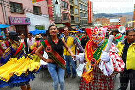 The official pepino and a beauty queen dancing during parades for the Entierro del Pepino, La Paz, Bolivia