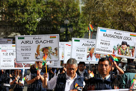 Members of the National Radio System for Indigenous Communities carry placards with pictures of president Evo Morales during Independence Day parades, La Paz, Bolivia