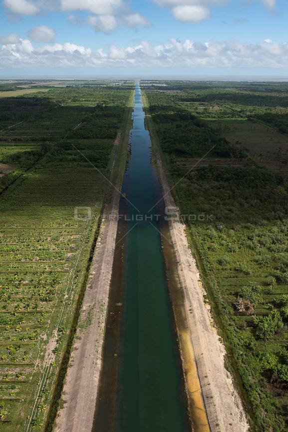 Hope canal, an irrigation canal in East Demerara Water Conservancy (for sugar cane and rice production) coastal area of Guyana, South America