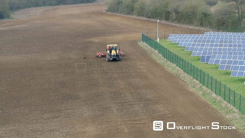 Farm Machinery Tractor Seed Drilling Barley. Solar Cell Farm. UK.