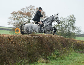 Stephen Rayns jumping a big hedge