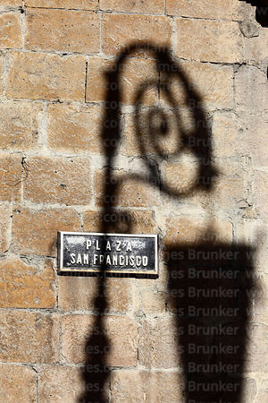 Plaza San Francisco sign and shadow of street lamp on wall of San Francisco church, La Paz, Bolivia