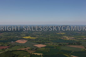 Malvern Hills aerial photograph showing a wide landscape view with a blue sky and horizon showing the agricultural landscape