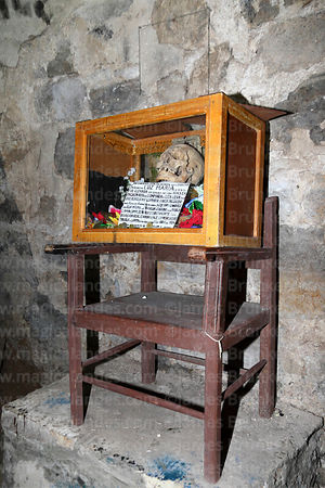 Skull of Luz Maria in catacombs of church of Santiago the Apostle / Immaculate Conception, Lampa, Peru