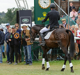Jonathan Paget is congratulated by CLIFTON PROMISE's owners Frances Stead and Russell Hall - show jumping phase, Burghley Horse Trials 2013.