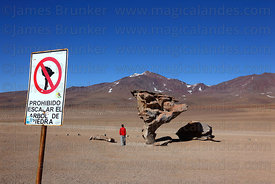 "Sign telling tourists not to climb on El Arbol de Piedra / "" The Rock Tree "" , Siloli Desert , Bolivia"