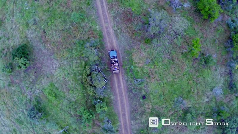 Aerial shot of a game vehicle driving through Phinda Game Reserve Phinda Private Game Reserve. KwaZulu Natal South Africa