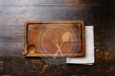 Wooden cutting board background and cloth napkin on wooden table background copy space