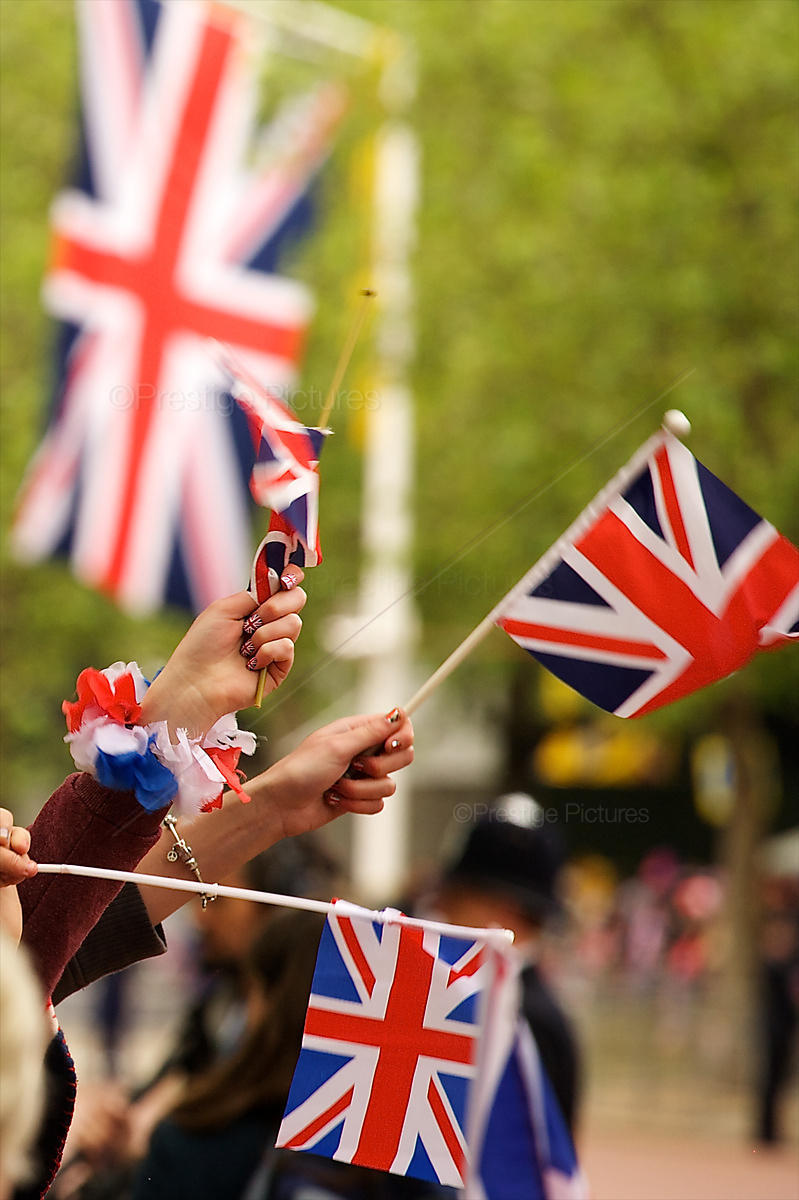 Union Jack Flags Held by Ladies with Union Jack Painted Fingernails