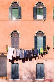 Facade of house with clothes hanging, Venice, Italy