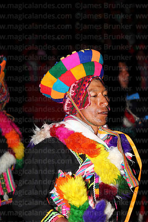 Male dancer performing in front of Sanctuary at night, Qoyllur Riti festival, Peru