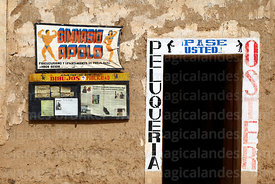 Adverts on wall of rustic hairdressers, Tarata, Cochabamba Department, Bolivia