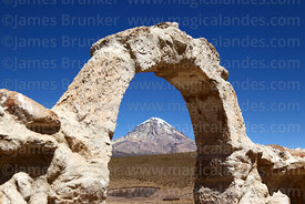 Entrance arch of church at Cotasaya and Sajama volcano, Sajama National Park, Bolivia