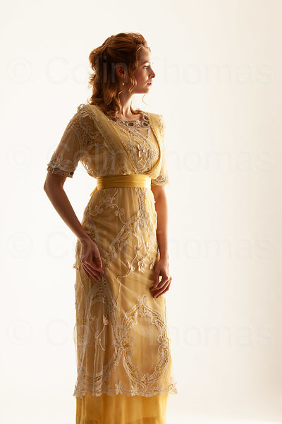 Woman in Victorian yellow dress photos