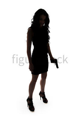 A Figurestock image of a woman, standing, holding a gun, in silhouette – shot from eye level.
