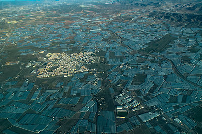 Aerial view of greenhouses surrounding the southern Spanish city of Campo Hermoso in Andalusia