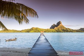 Jetty at sunrise, in the lagoon of Bora Bora, French Polynesia